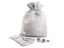 dinero en la batería Foto de archivo libre de regalías