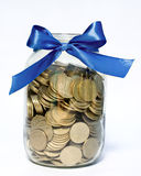 Dinero en la batería de cristal Fotos de archivo