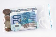Dinero en la bolsa de plástico Imagenes de archivo