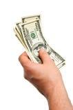 Dinero en la mano Fotos de archivo libres de regalías