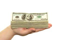 Dinero en la mano Imágenes de archivo libres de regalías
