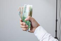 Dinero en la mano Fotografía de archivo libre de regalías