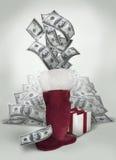 Dinero en la media de la Navidad foto de archivo libre de regalías
