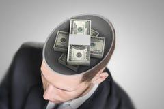 Dinero en la mente del hombre de negocios Foto de archivo libre de regalías
