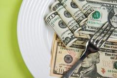 Dinero en la placa Foto de archivo