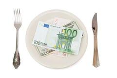 Dinero en la placa Imagen de archivo