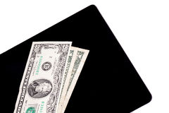Dinero en la tableta de Digitaces imagenes de archivo