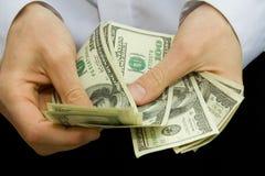 Dinero en las manos Fotografía de archivo libre de regalías