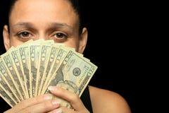 Dinero en las manos de la mujer Fotos de archivo