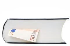 Dinero en libro Fotografía de archivo