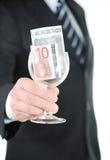 Dinero en los glas Imagenes de archivo