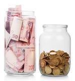 Dinero en los tarros de cristal Foto de archivo libre de regalías