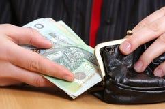 Dinero en manos Foto de archivo libre de regalías