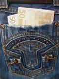 Dinero en pantalones vaqueros del bolsillo Fotografía de archivo libre de regalías