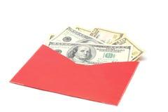 Dinero en sobre rojo Foto de archivo