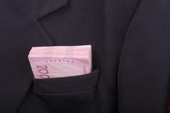 Dinero en su bolsillo Foto de archivo libre de regalías