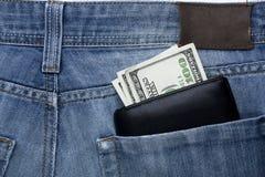 Dinero en bolsillo Imágenes de archivo libres de regalías
