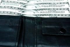 Dinero en un monedero Fotografía de archivo