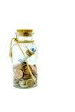 Dinero en un tarro Imágenes de archivo libres de regalías