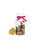 Dinero en un tarro Fotografía de archivo libre de regalías