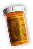 Dinero en una botella de píldora Imagenes de archivo