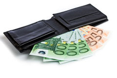 Dinero en una cartera Foto de archivo libre de regalías