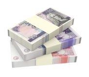 Dinero escocés y británico aislado en el fondo blanco Imagen de archivo