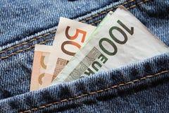 Dinero euro en el backpocket Imágenes de archivo libres de regalías