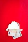 Dinero euro en fondo rojo Fotografía de archivo libre de regalías