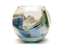 Dinero euro en la esfera de cristal Imagen de archivo