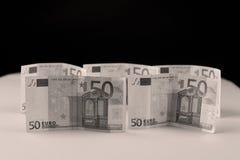 Dinero euro en un fondo blanco Imágenes de archivo libres de regalías