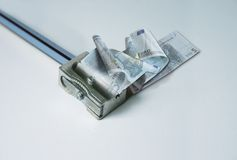 Dinero, euro y sacapuntas Fotografía de archivo