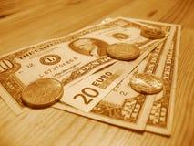 Dinero europeo y americano Fotos de archivo libres de regalías