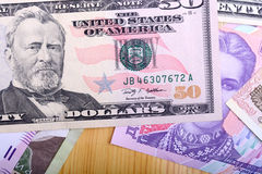 Dinero europeo y dólares americanos Imagen de archivo