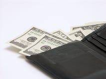Dinero fuera de la carpeta Imágenes de archivo libres de regalías