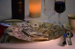 Dinero hambriento Imagen de archivo libre de regalías