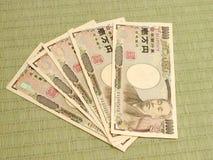 Dinero japonés en suelo de tatami imagen de archivo libre de regalías
