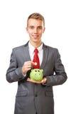 Dinero joven del ahorro del hombre de negocios Foto de archivo