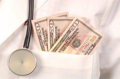 Dinero médico Imagenes de archivo
