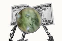 Dinero magnificado foto de archivo libre de regalías