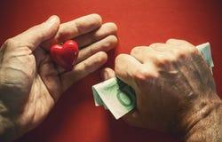 Dinero o amor Fotografía de archivo libre de regalías
