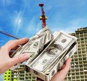 Dinero para comprar un nuevo hogar Imágenes de archivo libres de regalías