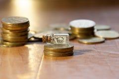 Dinero para el hogar Foto de archivo libre de regalías