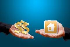 Dinero para la casa Foto de archivo libre de regalías