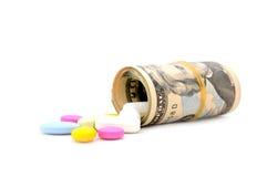 Dinero para la medicina imagen de archivo libre de regalías
