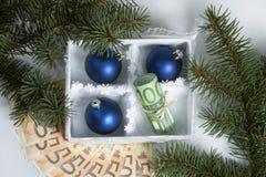 Dinero para la Navidad Imagenes de archivo