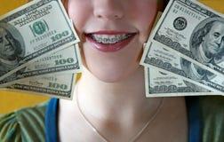Dinero para las paréntesis Imagen de archivo libre de regalías
