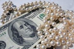Dinero para las perlas Imagenes de archivo