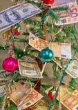 Dinero para los regalos de la Navidad Fotos de archivo