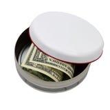 Dinero pasado en la lata redonda aislada Imagen de archivo